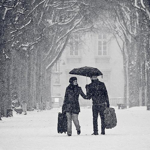 Couple under rain via flickr by Gregory Bastien